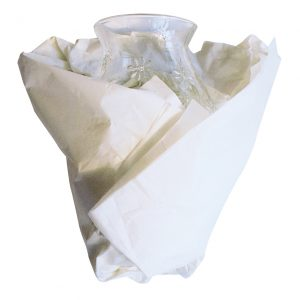 Glass vase wrapped in packing paper