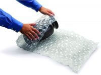 Rolling a vase in bubble wrap